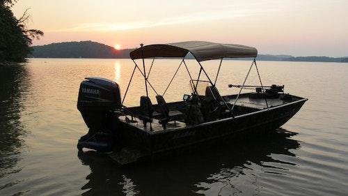 Carver Bimini Top on Jon Fishing Boat Sunbrella Toast