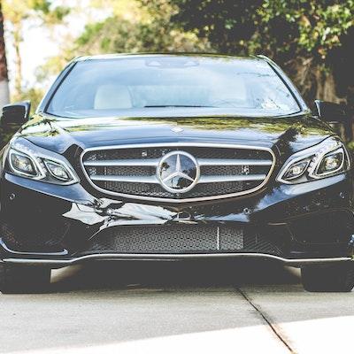 Black Mercedes E-Class in Sun